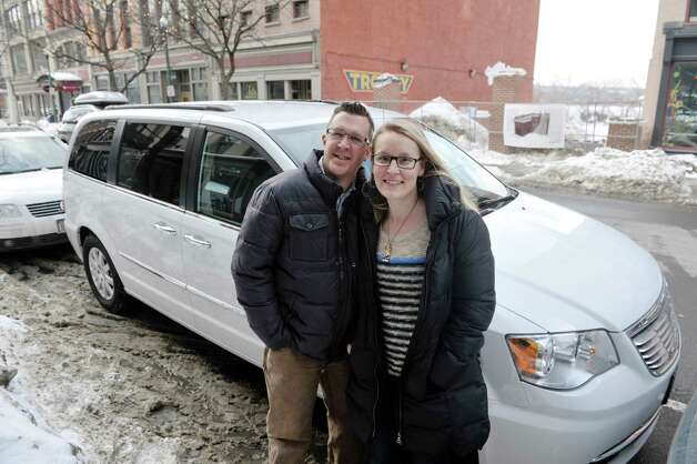 Couple, John and Sarah Trop pose for a photograph in front of their mini-van outside their store FunCycled on Monday, March 2, 2015, in Troy, N.Y.  The owners, Sarah and John Trop recently won a $5,000 prize on an HGTV reality show and used some of the money to buy the van.  (Paul Buckowski / Times Union) Photo: PAUL BUCKOWSKI / 00030824A