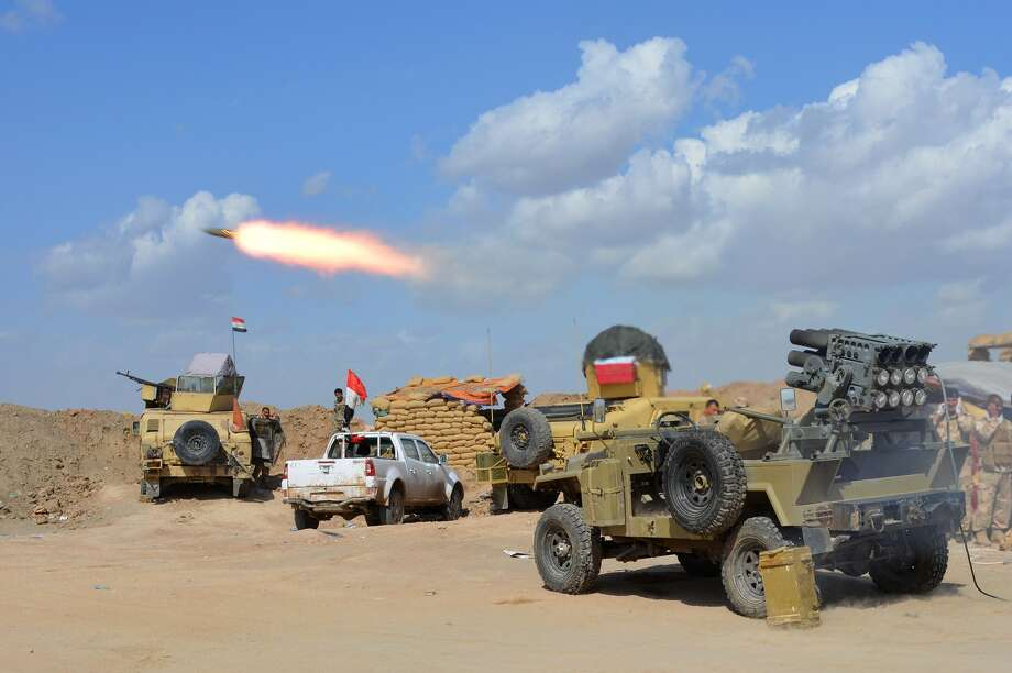 Iraqi government forces and allied militias take part in an assault to retake the city of Tikrit from the Islamic State. Photo: Younis Al-Bayati /Getty Images / AFP