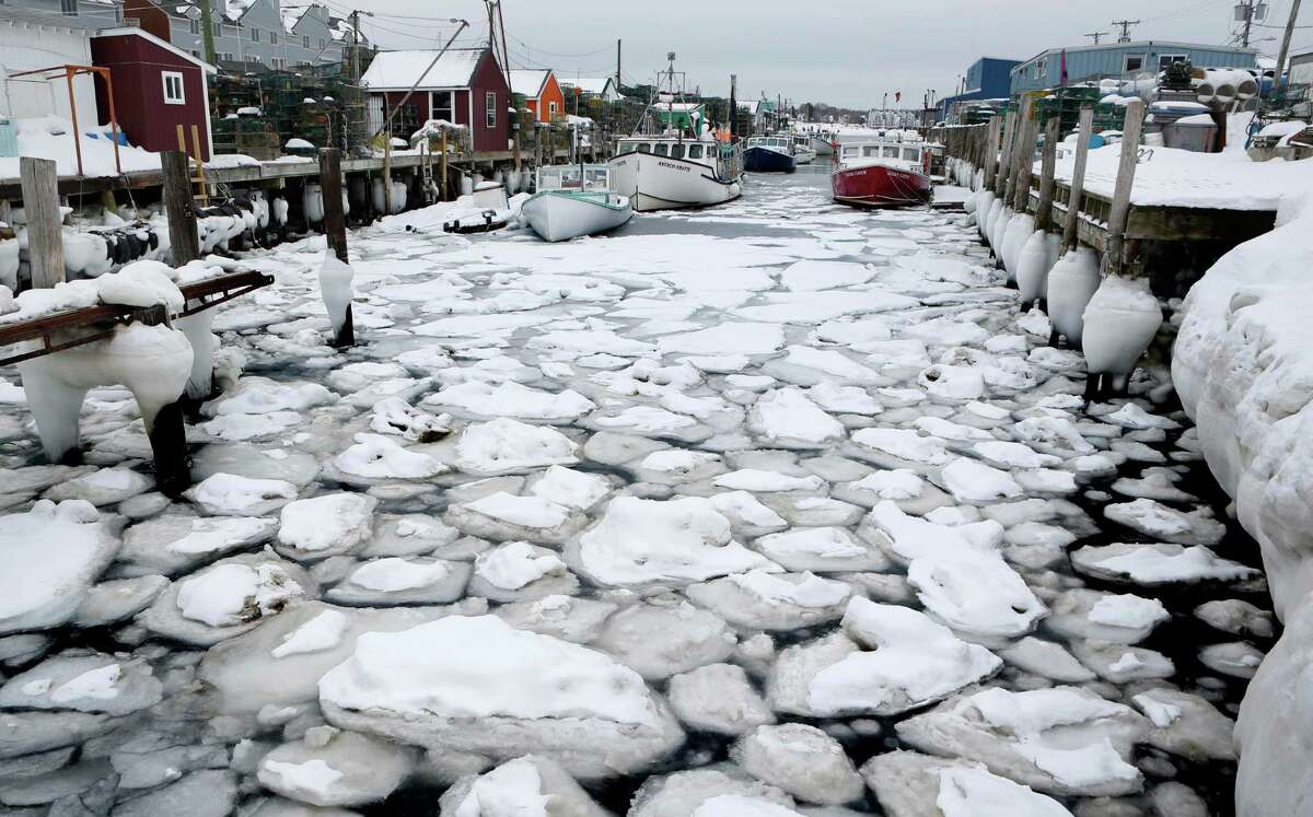 Ice clogs the water between wharves in Portland, Maine where Portland Harbor is encountering more ice than it has in years thanks to the coldest February on record. Several lobster boats were locked in the ice, unable to move, and ice breakers are needed to keep commerce flowing. (AP Photo/Robert F. Bukaty)