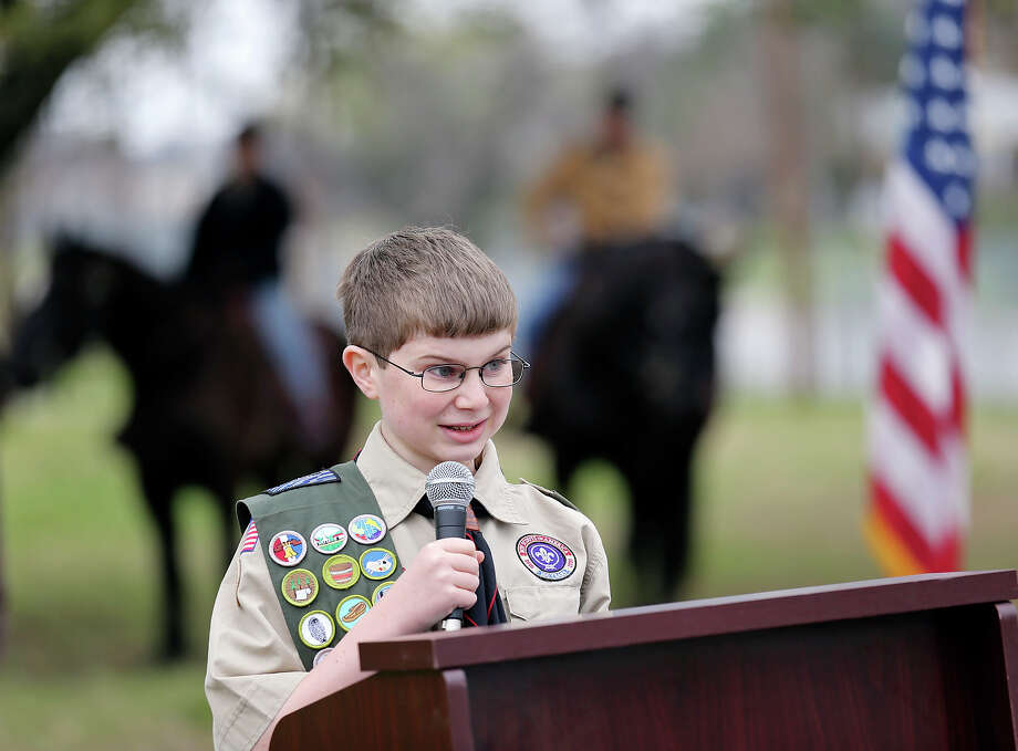 Troop 23 Life Scout Michael Harger, 13, speaks during a memorial service for Pat the military horse at his grave site at Fort Sam Houston. The service, held on the 62nd anniversary of Pat's death, was part of Michael's Eagle Scout project. He raised more than $1,000 to create a storyboard that was unveiled at the memorial service. He also built a 3-D table with a map of Fort Sam Houston National Cemetery in the caisson orderly room to help visitors get to locations for funerals. Photo: Edward A. Ornelas /San Antonio Express-News / © 2015 San Antonio Express-News