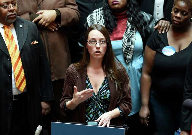 Erin Boyle Acosta, mother of a student, speaks in favor of the Governor's Opportunity Agenda during a Charter School Advocates demonstration Monday afternoon Mar. 2, 2015 in the State Capitol in Albany, N.Y.       (Skip Dickstein/Times Union) Photo: SKIP DICKSTEIN / 00030825A