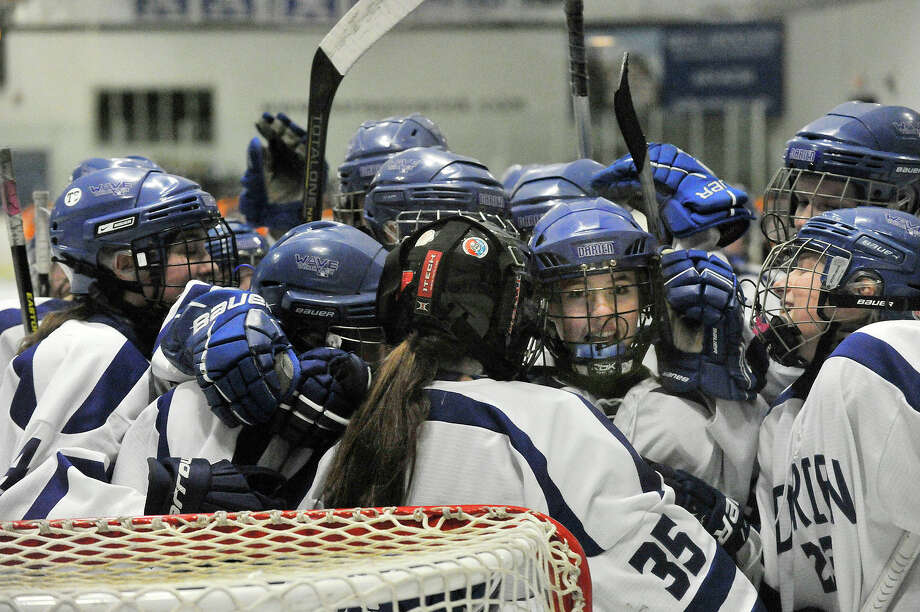 The Darien girls celebrate their 5-1 state quarterfinal hockey game win over Ridgefield at Darien Ice Rink in Darien, Conn., on Monday, March 2, 2015. Photo: Jason Rearick / Stamford Advocate