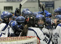The Darien girls celebrate their 5-1 state quarterfinal hockey game win over Ridgefield at Darien Ice Rink in Darien, Conn., on Monday, March 2, 2015.
