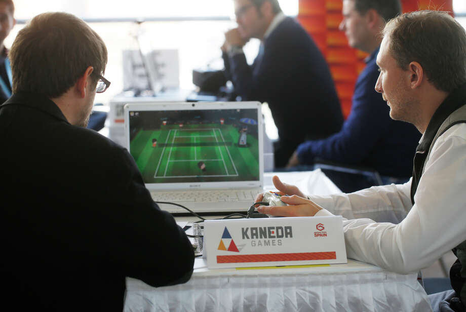 Game developers and investors meet at Game Connection America, happening just down the street from the larger Game Developers Conference. Pictured are Jordi Anrnal Montoya, of of Kaneda Games out of Barcelona, Spain (left) shows Julien Ramette of Bandai Namco Games in Paris France a new tennis game on Monday March 2, 2015 in San Francisco, Calif. Photo: Mike Kepka / The Chronicle / ONLINE_YES