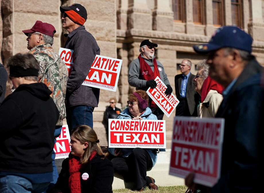 Activists belonging to the tea party movement convene at a rally at the Texas State Capitol to make their views known. The demonstrators picketed demanding true conservative values from elected officials. Photo: Ben Sklar, Getty Images / 2011 Getty Images