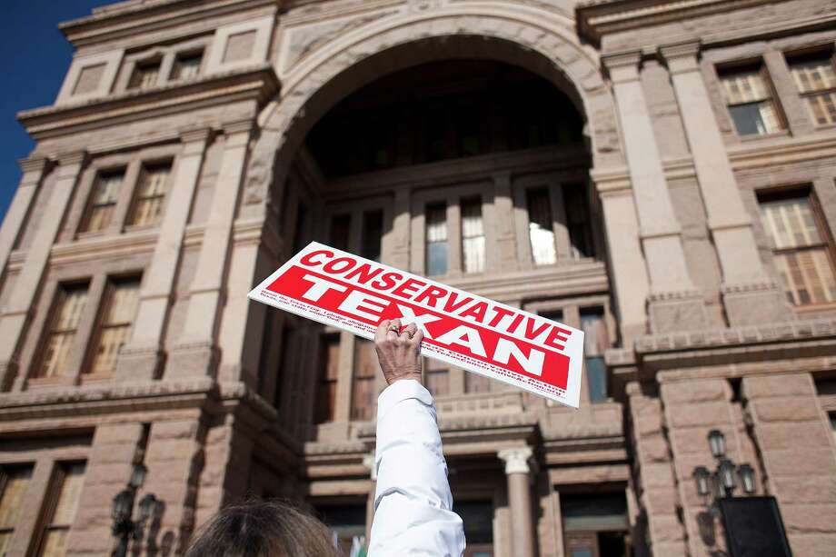AUSTIN, TX- JANUARY 11:  A person holds a sign as others belonging to the Tea Party movement convene at a rally at the Texas state capitol during the first day of the 82nd Legislative session on January 11, 2011 in Austin, Texas. The demonstrators picketed demanding true conservative values from elected officials. Photo: Ben Sklar, Getty Images / 2011 Getty Images