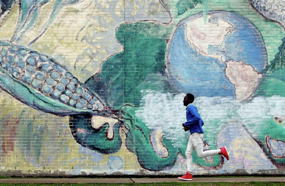 Khalid Abdulkhalik, 17, of Sudan, runs to class at Lee High School.