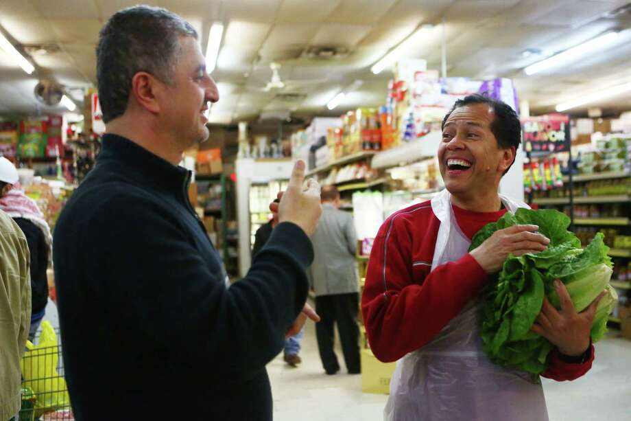 Jerusalem Halal Meats co-owner Maher Hassouneh communicates in sign language with his employee, Alfonso Reyes, who is from Honduras.  Photo: Marie D. De Jesus, Houston Chronicle / © 2015 Houston Chronicle