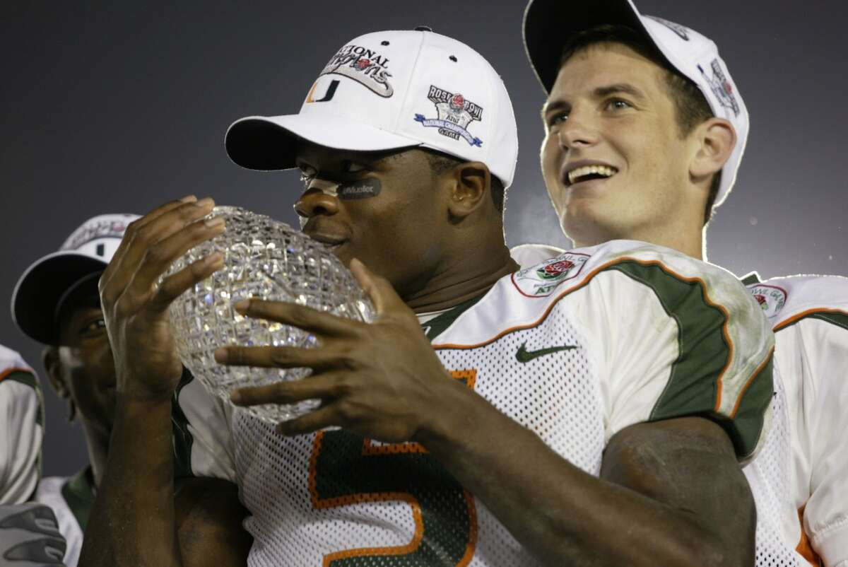 3 Jan 2002: Andre Johnson #5 of Miami hugs the Sears National Championship trophy as quarterback Ken Dorsey #11 looks on after winning the Rose Bowl National Championship game over Nebraska at the Rose Bowl in Pasadena, California. Miami won the game 37-14, winning the BCS and the National Championship title. DIGITAL IMAGE. Mandatory Credit: Robert Laberge/Getty Images