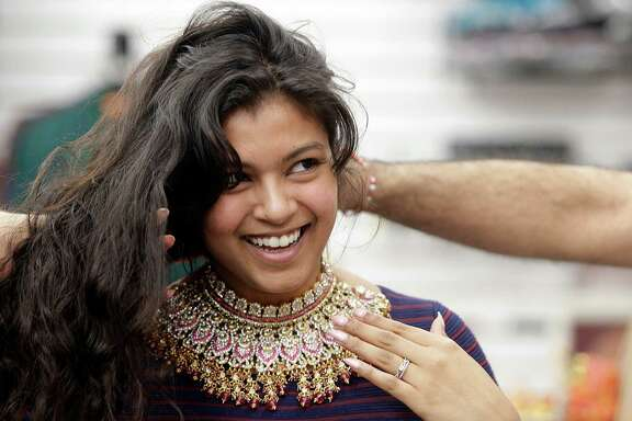 Million for La Voz  Gurya Jivani, 27, tries on jewelry for her traditional Pakistani wedding on Wednesday, Feb. 11, 2015, in Houston. Gurya Jivani, a 1st generation american from a Pakistani family, and she thinks it's important to follow her Pakistan family traditions.