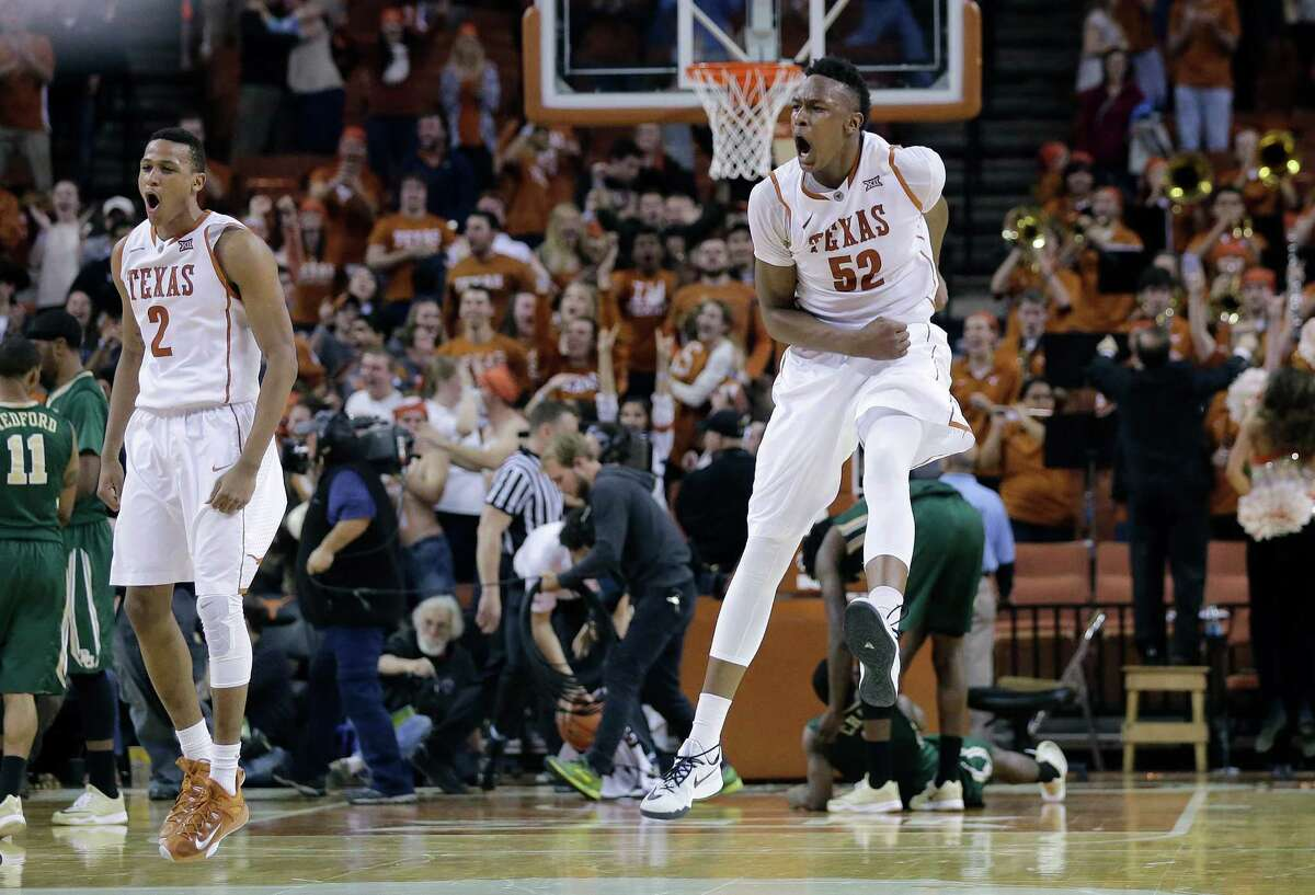 Texas?' Myles Turner (52) celebrates with teammates after he blocked a shot in the final seconds of overtime in an NCAA college basketball game against Baylor, Monday, March 2, 2015, in Austin, Texas. Texas won 61-59.(AP Photo/Eric Gay)