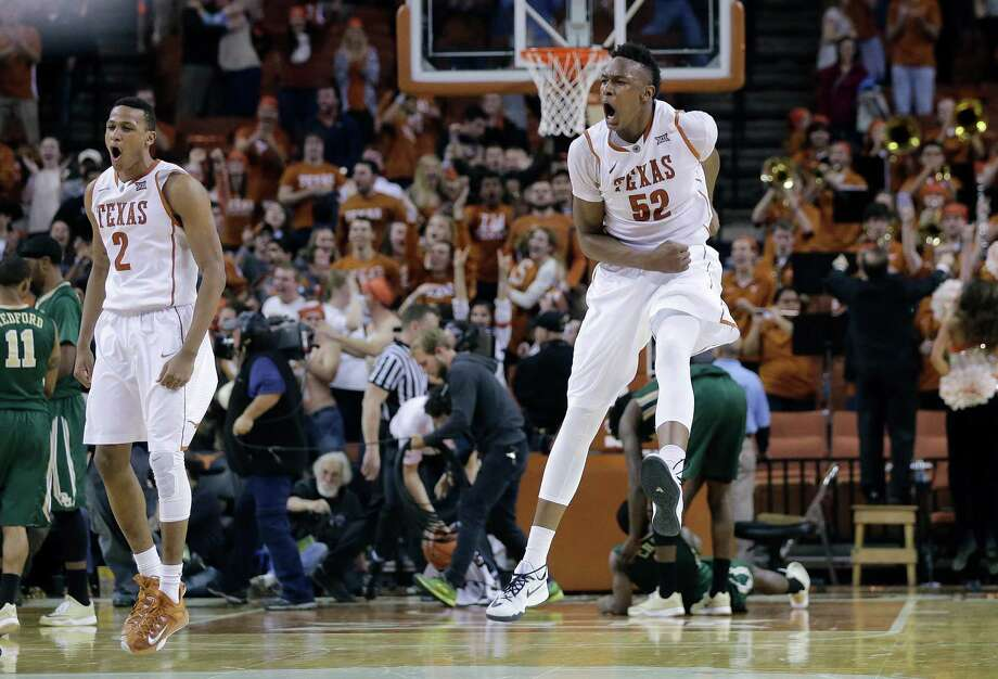 Texas' Myles Turner (52) celebrates with teammates after he blocked a shot in the final seconds of overtime in an NCAA college basketball game against Baylor, Monday, March 2, 2015, in Austin, Texas. Texas won 61-59.(AP Photo/Eric Gay) Photo: Eric Gay, STF / Associated Press / AP