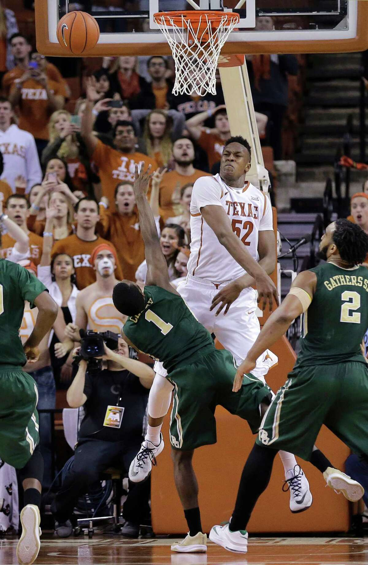 Texas?' Myles Turner (52) blocks a shot by Baylor?'s Kenny Chery (1) during the final seconds of overtime in an NCAA college basketball game, Monday, March 2, 2015, in Austin, Texas. Texas won 61-59. (AP Photo/Eric Gay)