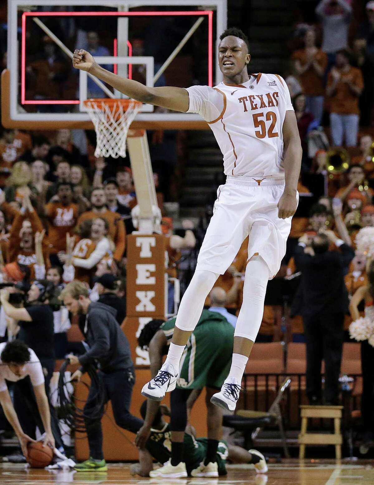 Texas?' Myles Turner celebrates with teammates after he blocked a shot in the final seconds of overtime in an NCAA college basketball game against Baylor, Monday, March 2, 2015, in Austin, Texas. Texas won 61-59.(AP Photo/Eric Gay)