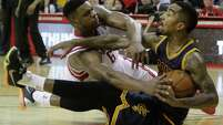 Playoff-style intensity was evident throughout the 53 minutes it took Sunday for the Rockets to beat the Cavaliers, including a scramble between Terrence Jones, left, and Cleveland's J.R. Smith during overtime.