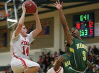 Fairfield Prep's #14 Richard Kelly  shoots to the basket during Monday evening SCC semifinals against Hamden High School. Fairfield Prep would win 68-51.
