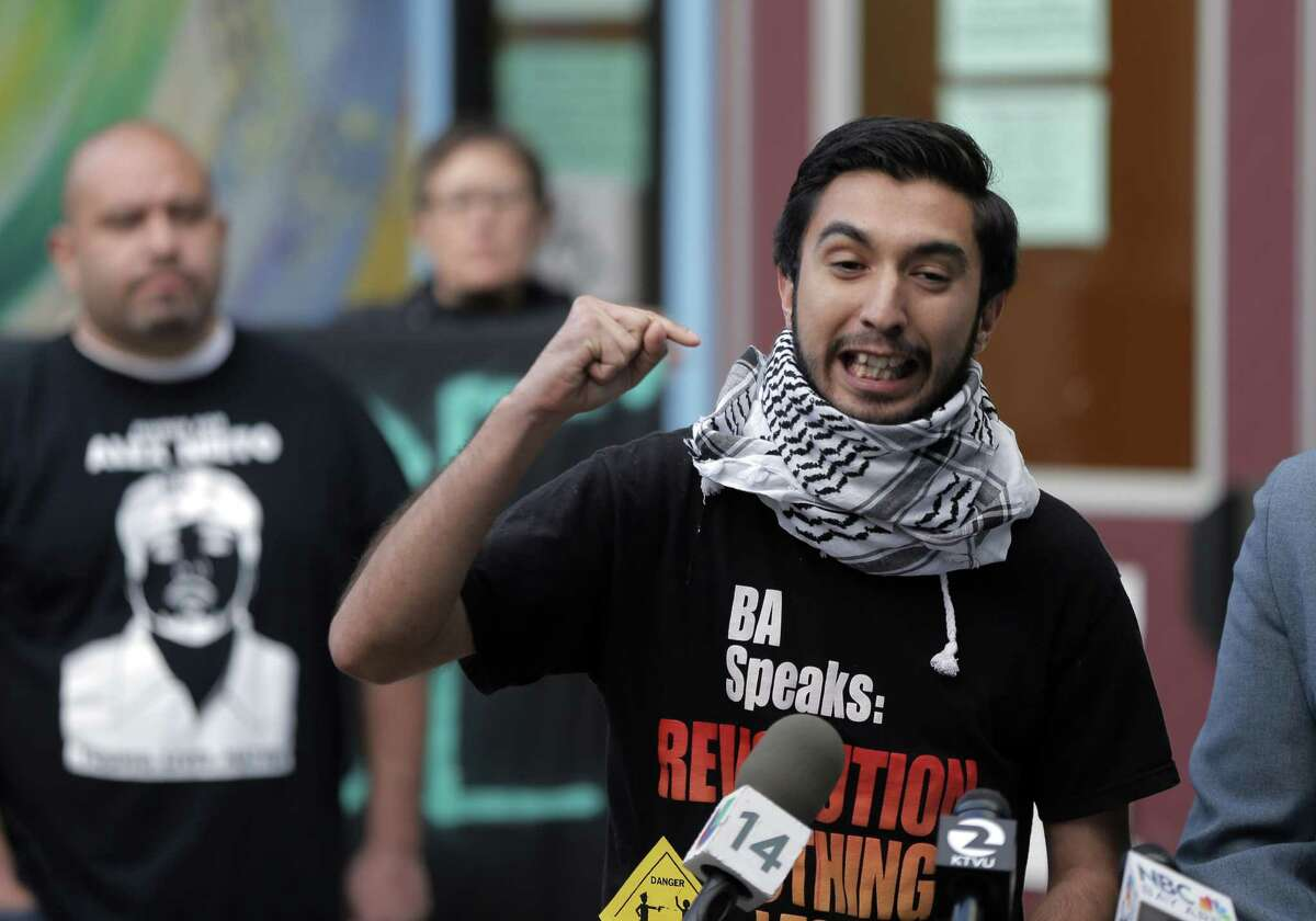 David Santos with Stop Mass Encarcerations Network speaks out before a police town hall meeting on Monday, March 2, 2015, in San Francisco, Calif., to address the officer-involved shooting of Amilcar Perez-Lopez, who was killed the previous Thursday.