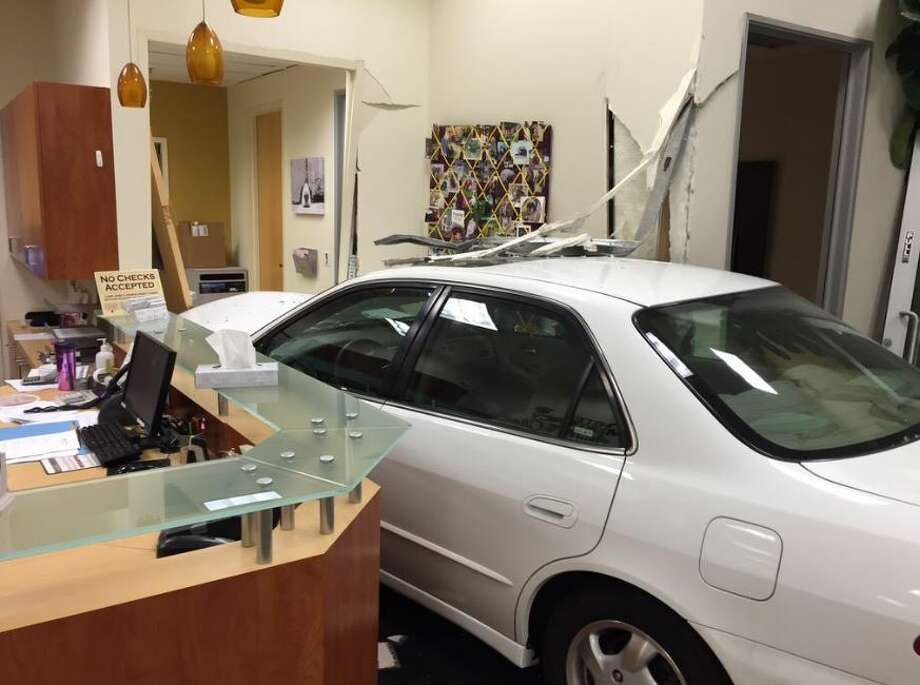 A white Honda sedan crashed through the front doors of a pet clinic in Campbell on Monday. Photo: Courtesy / Campbell Police / ONLINE_YES