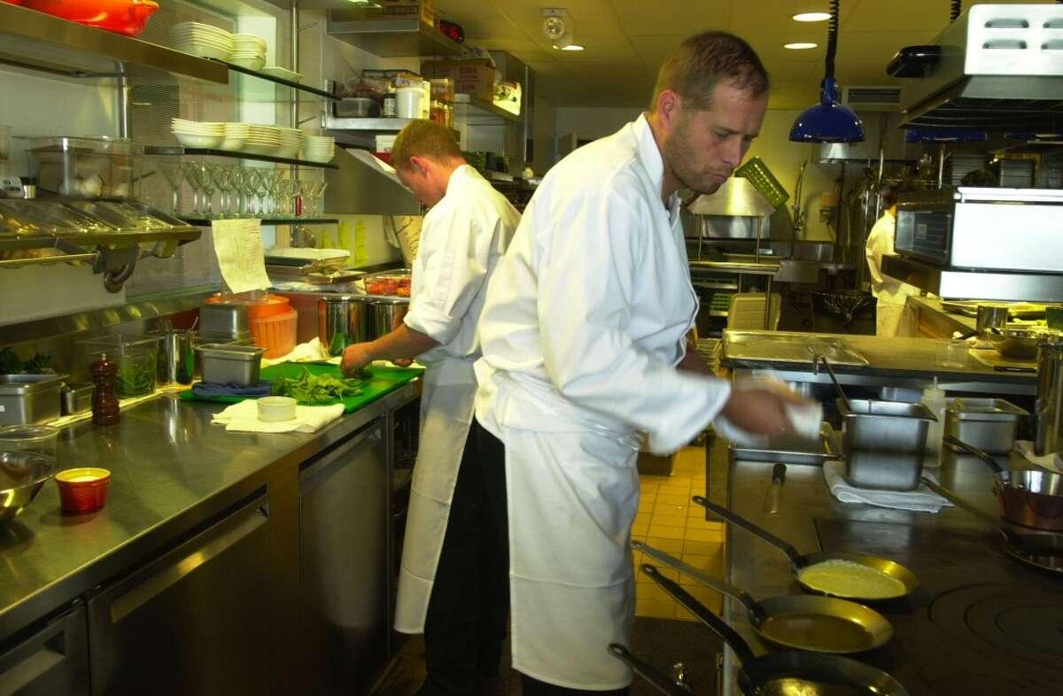 2002: Chef David Kinch works on making crepes for dinner at Manresa.