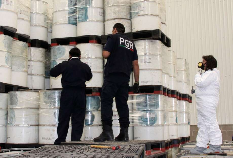 Warehouse of chemicals Mexican police investigators in 2012 look at drums of precursor chemicals for methamphetamine that were seized in Queretaro, Mexico. Over the last several years, the cartels have quietly swooped in to fill a void in the American drug market created by years of crackdowns that began more than a decade ago.(AP Photo/Mexico Attorney General's office) Photo: Anonymous, Associated Press