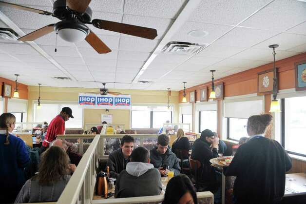 Customers fill the IHOP on Wolf Road during National Pancake Day on Tuesday, March 3, 2015, in Colonie, N.Y.  For every short stack of buttermilk pancakes served on National Pancake Day IHOP guests are invited to make a voluntary donation to the Bernard & Millie Duker Children's Hospital at Albany Med.  For the 10th consecutive year, Capital District IHOP restaurants will offer guests a free short stack of buttermilk pancakes on Tuesday, March 3, National Pancake Day.  (Paul Buckowski / Times Union) Photo: PAUL BUCKOWSKI / 00030826A