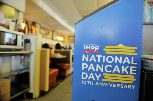 Customers enjoy pancakes at the IHOP on Wolf Road during National Pancake Day on Tuesday, March 3, 2015, in Colonie, N.Y.  For every short stack of buttermilk pancakes served on National Pancake Day IHOP guests are invited to make a voluntary donation to the Bernard & Millie Duker Children's Hospital at Albany Med.  For the 10th consecutive year, Capital District IHOP restaurants will offer guests a free short stack of buttermilk pancakes on Tuesday, March 3, National Pancake Day.  (Paul Buckowski / Times Union) Photo: PAUL BUCKOWSKI / 00030826A