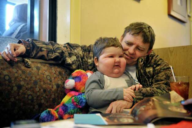 Chase Foley, 3, and his father, Chris Foley from Albany eat breakfast at the IHOP on Wolf Road during National Pancake Day on Tuesday, March 3, 2015, in Colonie, N.Y.  Chase is recovering from leukemia and is being treated at Albany Med.  For every short stack of buttermilk pancakes served on National Pancake Day IHOP guests are invited to make a voluntary donation to the Bernard & Millie Duker Children's Hospital at Albany Med.  For the 10th consecutive year, Capital District IHOP restaurants will offer guests a free short stack of buttermilk pancakes on Tuesday, March 3, National Pancake Day.  (Paul Buckowski / Times Union) Photo: PAUL BUCKOWSKI / 00030826A