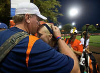 KISSIMMEE, FL - AUGUST 1:Mass Drifters Coach Curt Schilling, right, kisses his daughter, Gabby, after two come-from-behind victories during a USSA Girls Fastpitch World Series II. (Photo by Stan Grossfeld/The Boston Globe via Getty Images)