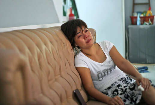 "Yenny, the sister of Sugianto Lo who was onboard  the Malaysia Airlines plane MH370, weeps on the couch as she watches a news update on the search of the wreckage of the jetliner at their family residence in Medan, North Sumatra, Indonesia, Tuesday, March 25, 2014. After 17 days of desperation and doubt over the missing Malaysia Airlines jet, the country's officials said an analysis of satellite data points to a ""heartbreaking"" conclusion: Flight 370 met its end in the southern reaches of the Indian Ocean, and none of those aboard survived. (AP Photo/Binsar Bakkara) Photo: Binsar Bakkara, Associated Press / AP2014"