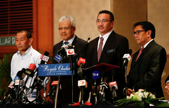 "Malaysia's Defense Minister and acting Transport Minister Hishammuddin Hussein, second right, speaks druing a press conference on the missing Malaysia Airlines MH370 at a hotel in Kuala Lumpur, Malaysia, Monday, April 7, 2014. Hishammuddin says he is ""cautiously hopeful"" that there will be positive developments in the next few days, ""if not hours,"" in the search for the missing airliner. They are, from left, Malaysia Airlines Group CEO Ahmad Jauhari Yahya, Deputy Minister of Foreign Affairs Hamzah Zainudin, Hishammuddin and Director general of the Malaysian Department of Civil Aviation Azharuddin Abdul Rahman. (AP Photo/Vincent Thian) Photo: Vincent Thian, Associated Press / AP"