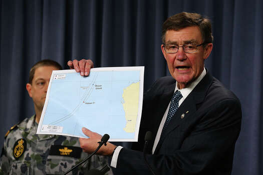 Air Chief Marshal Angus Houston (ret'd) holds a map outlining the current search areas of naval ships Ocean Shield and Haixun 01 during a press conference for the continuing search of missing Malaysia Airlines Flight MH370 at Dumas House on April 7, 2014 in Perth, Australia. Angus Houston confirmed today that the Australian naval vessel Ocean Shield has twice detected signals in the past 24 hours consitent with aircraft black boxes. The airliner disappeared on March 8 with 239 passengers and crew on board and is suspected to have crashed into the southern Indian Ocean. Photo: Paul Kane, Getty / 2014 Getty Images