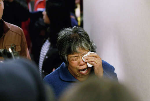 A family member of a passenger from the missing Malaysia Airlines flight MH370 reacts at Lido Hotel on March 24, 2014 in Beijing, China. Malaysian Prime Minister announced that Flight MH370 crashed Into Southern Indian Ocean, citing analysis of satellite data. Photo: Lintao Zhang, Getty / 2014 Getty Images