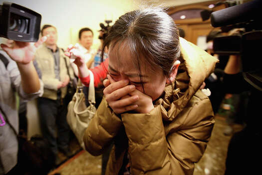 A relative of a passenger onboard Malaysia Airlines flight MH370 cries out at a local hotel where families are gathered on March 9, 2014 in Beijing, China. Malaysia Airline Flight MH370 from Kuala Lumpur to Beijing and carrying 239 onboard was reported missing after the crew failed to check in as scheduled while flying over the sea between Malaysia and Ho Chi Minh City in Vietnam, according to published reports. Photo: Feng Li, Getty / 2014 Getty Images