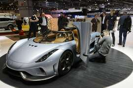 The New Koenigsegg Regera is presented during the first press day at the 85th Geneva International Motor Show in Geneva, Switzerland, Tuesday, March 3, 2015. The Motor Show will open its gates to the public from March 5th to 15th. (AP Photo/Keystone, Martial Trezzini)