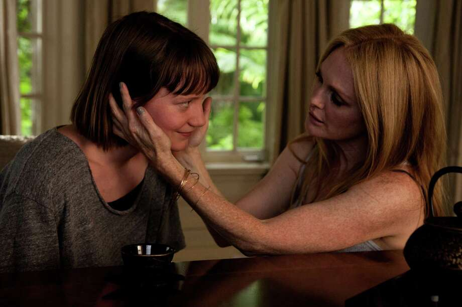 """Maps to the Stars"": A physically scarred young woman (Mia Wasikowska) links the tawdry tales of an aging actress (Julianne Moore) and a privileged child star (Evan Bird) in this pitch-black satire. At first you credit the movie's chilly perfection to director David Cronenberg but ascribe the rest to Hollywood-slaying author Bruce Wagner, who wrote the screenplay. Once the horror happens, you know you have been trapped in director David Cronenberg's nightmare all along. (Available to buy and rent) Photo: Courtesy Focus World / TNS"