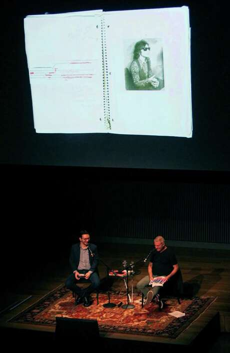 New York Times culture reporter Randy Kennedy (left) moderates a conversation with photographer Jim Goldberg about his work at the SFJAZZ Center, Wednesday, Feb. 25, 2015, in San Francisco, Calif. Goldberg's first photo taken is displayed on the large screen. Photo: Santiago Mejia / The Chronicle / ONLINE_YES