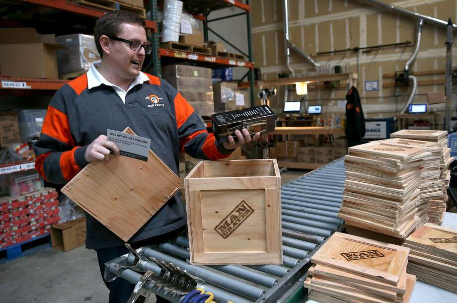 Founder and CEO Jonathan Beekman reviews items included in the whiskey connoisseur box at the Man Crates warehouse in Redwood City, Calif. on Friday, Feb. 27, 2015. Man Crates sells items geared for men and are shipped in ammo boxes or wooden crates that are opened with included crowbars. Photo: Paul Chinn, The Chronicle