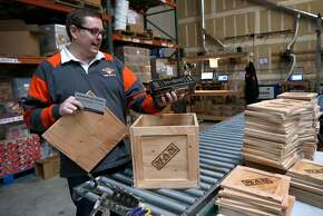 Founder and CEO Jonathan Beekman reviews items included in the whiskey connoisseur box at the Man Crates warehouse in Redwood City, Calif. on Friday, Feb. 27, 2015. Man Crates sells items geared for men and are shipped in ammo boxes or wooden crates that are opened with included crowbars.