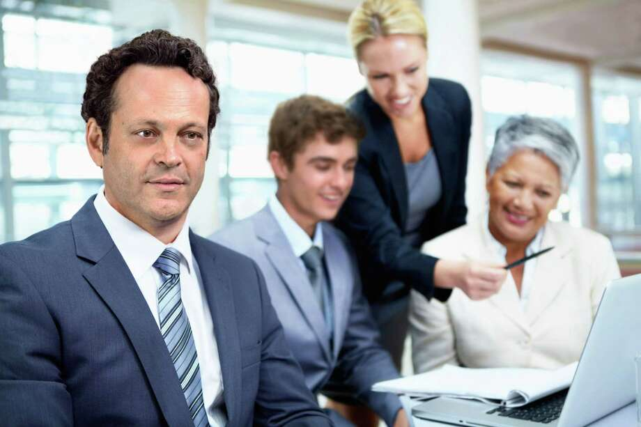 """The cast of """"Unfinished Business"""" are featured in a free series of stock images available exclusively at www.iStock.com. Here's a dazed Vince Vaughn wondering why they're still using paper tablets in an office equipped with laptops. Photo: IStock Photo / Getty Images"""