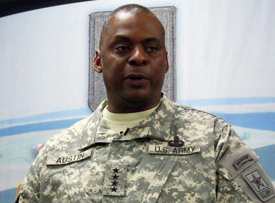 FILE - In this July 27, 2012 file photo, Gen. Lloyd Austin speaks to reporters at Fort Riley, Kansas. The U.S.-led military coalition in Iraq has killed more than 8,500 Islamic State fighters since its bombing campaign began in August and has gained the upper hand, the top general overseeing the coalition said Tuesday. Austin, the commander of U.S. Central Command, said the Islamic State, which has controlled key parts of northern and western Iraq since last summer, is no longer capable of seizing and holding new territory.  (AP Photo/John Milburn, File). Photo: John Milburn / Associated Press / AP