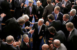 Israeli Prime Minister Benjamin Netanyahu shakes hands as he leaves the House chamber on Capitol Hill.