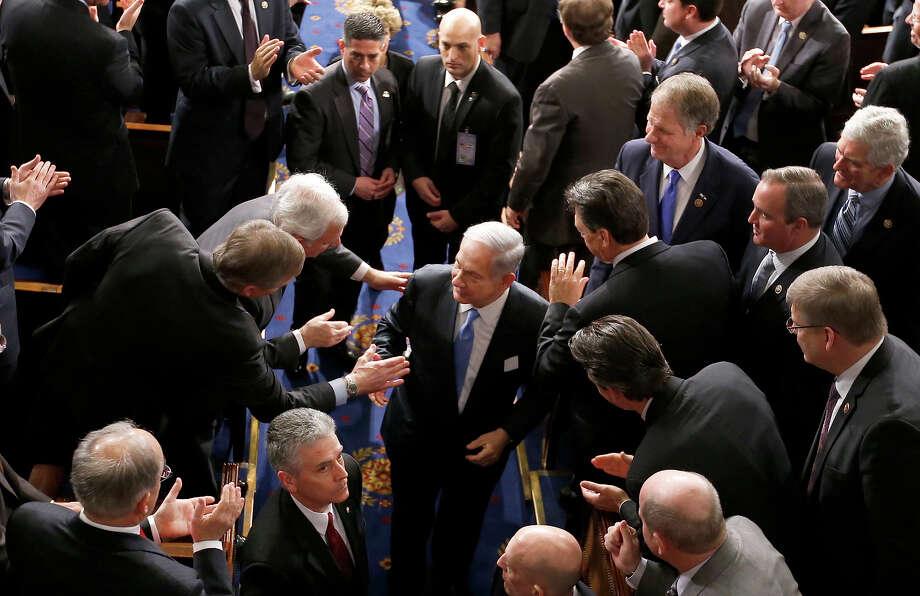 Israeli Prime Minister Benjamin Netanyahu shakes hands as he leaves the House chamber on Capitol Hill. Photo: Andrew Harnik / Associated Press / AP