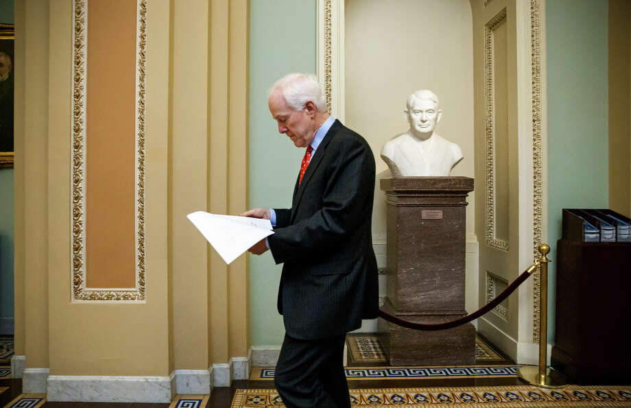 Senate Majority Whip John Cornyn, R-Texas, heads to the chamber for a procedural vote on a funding bill for the Department of Homeland Security that had generated partisan gridlock. Photo: J. Scott Applewhite / Associated Press / AP