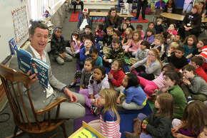 Lt. Gov. Gavin Newsom reads to kindergartners in Sacramento. He wants to be governor. Should he be president?