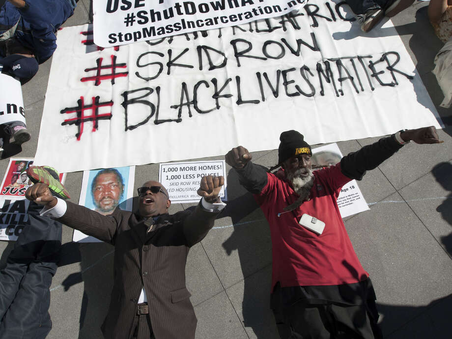 Demonstrators stage a die-in at a protest outside the headquarters of the Los Angeles Police Department against the fatal shooting of an unarmed man. Photo: David McNew / Getty Images / 2015 Getty Images