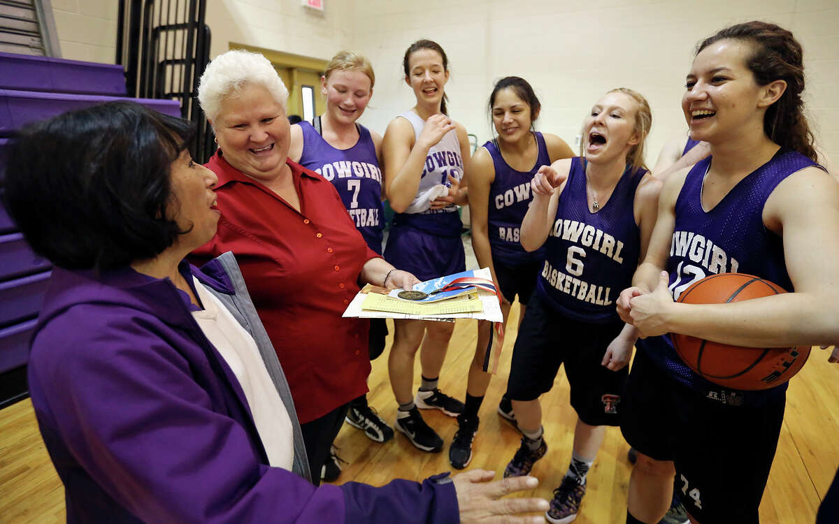 Members of the 1979 D'Hanis Cowgirls basketball team - Sally Contreras-Cuellar (left) and Laurie Zinsmeyer-Santos - joke with current members of the team Ashley Philipp, Morgan Lynch, Crysta Salazar, Mallory McCollum, and Sarah Craft during practice on March 2, 2015.