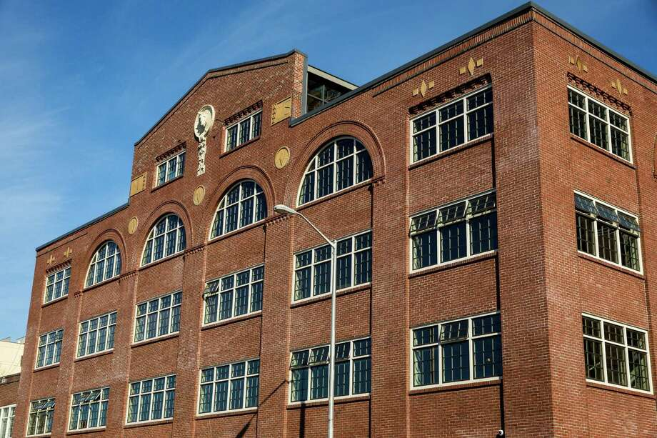 Views of the exterior of the newly renovated Union Stables Tuesday, March 3, 2015, in Seattle, Washington. Listed on the National Historic Register, Union Stables was completed in 1910 and housed 300 horses used to pull SeattleÕs street cars and fire engines. Photo: JORDAN STEAD, SEATTLEPI.COM / SEATTLEPI.COM