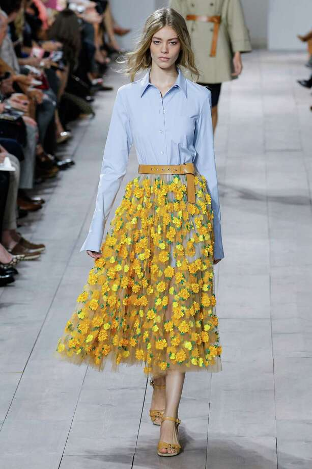 Floral prints, big and small, are an important spring 2015 trend as seen in this look from Michael Kors. Photo: Thomas Concordia / WireImage / 2014 Thomas Concordia