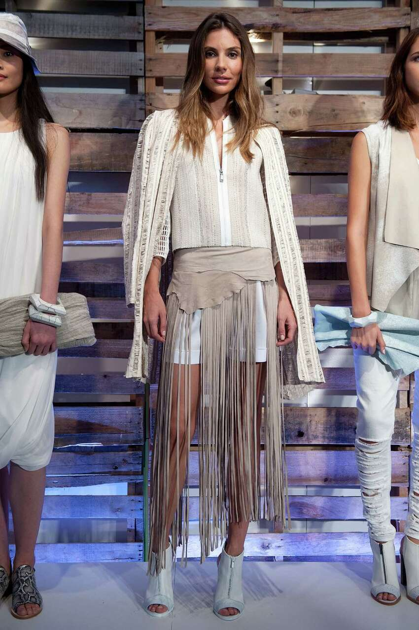 Fringe on a variety of garments and accessories will be trending for spring 2015 trend as seen in this look from Elie Tahari.