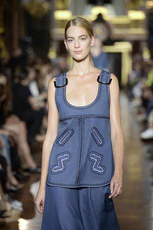 Demin will be a hot fabric this spring on a variety of garments from tunics to skirts to shorts as seen in this look from Stella McCartney. Photo: Catwalking / Getty Images / 2014 Catwalking